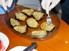 Michalis prepares the eggplants for the stuffing